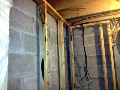 Basement wall insulation applications using spray for Basement wall insulation blanket