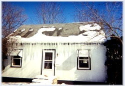 This Home Has Major Ice Dams That Are Blocking The Front Entrance To The Home ~ Click for larger image